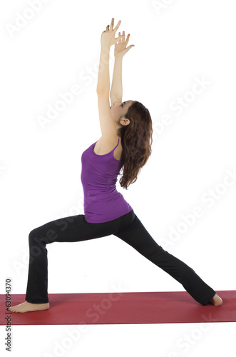 Woman in Warrior I Pose in yoga