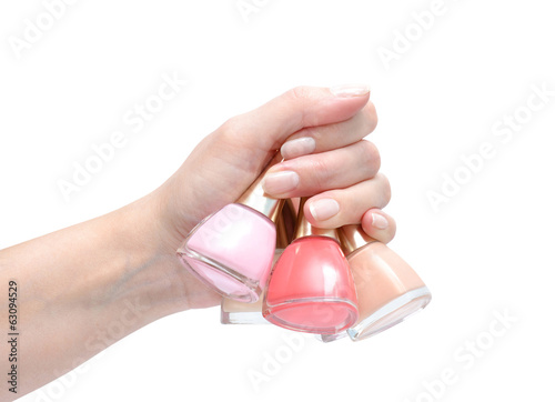 hand with nail polishes