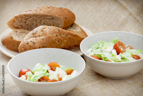 Two fetta salad portions and slices of bread