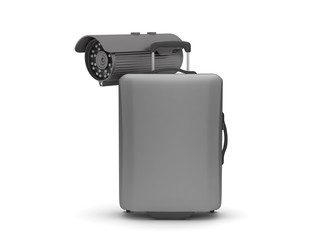 Suitcase and security cam on white background