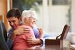 Teenage Grandson Hugging Grandmother