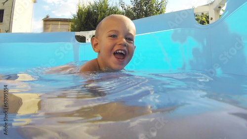 Little Child Playing in the Swimming Pool