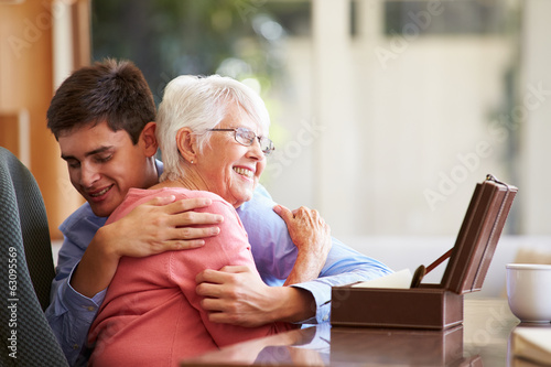 Teenage Grandson Hugging Grandmother