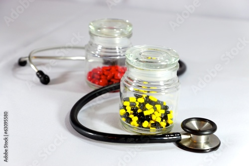 two bottles of medicine and stethoscope