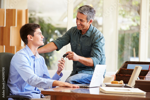 Father Giving Teenage Son Car Keys