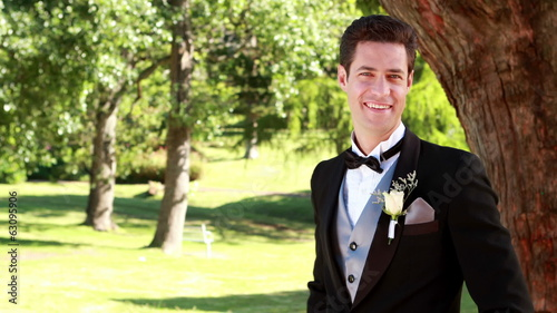 Attractive groom smiling at camera