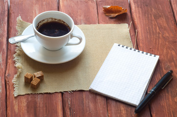 Cup Of Coffee and Open notebook