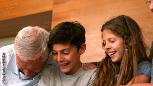 Grandparents laughing with their grandchildren