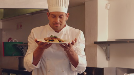 Chef smelling a dish