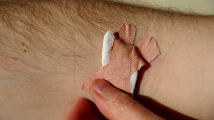 Adhesive plaster on hand