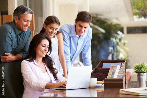 Family Looking At Laptop Together