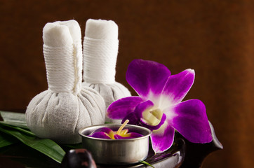 Spa herbal compressing ball with candles and orchid