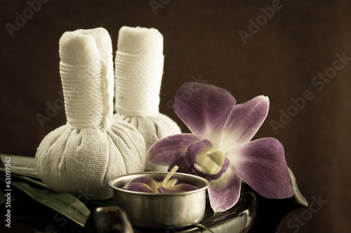 Spa herbal compressing ball with candles and orchid.