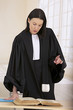 woman lawyer preparing her speech for the defense - 63097571