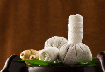 Spa herbal compressing ball with herbs and leaf .