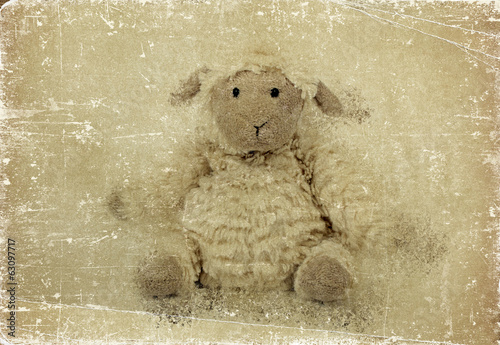 Cute sheep toy. Grunge effect.