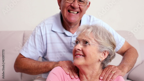 Senior man giving his wife a shoulder rub