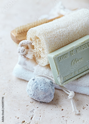 Organic Bath Accessories on a Travertine Background