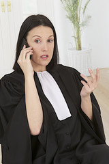 woman lawyer French  on the phone