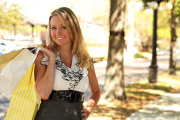 Pretty blonde woman with shopping bags portrait