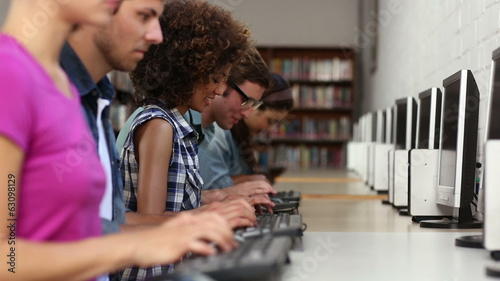 Students sitting in a row working on computers