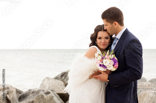 Loving bride and groom near the sea.