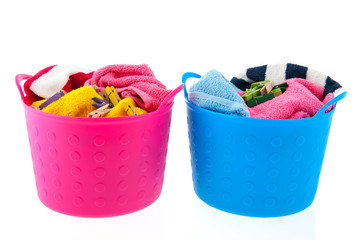 Laundry baskets in pink and blue