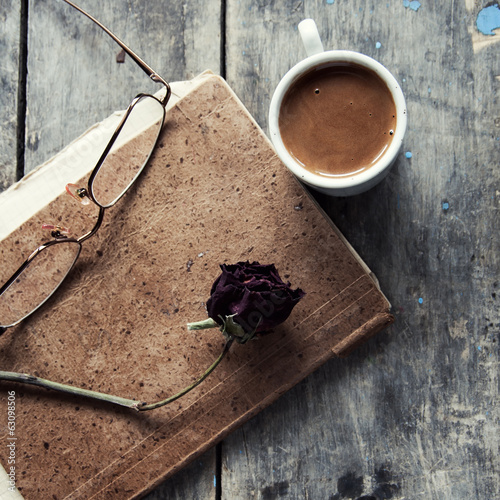 dried rose on old notebook