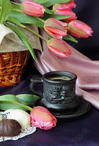 Cup of coffee and a bouquet of tulips