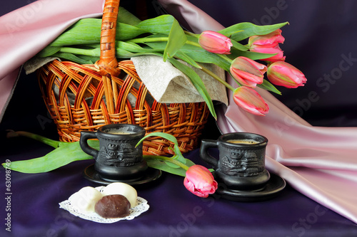 Morning coffee , basket with a bouquet of tulips