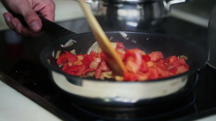 Mans hand preparing salsa in his kitchen, steadicam shot