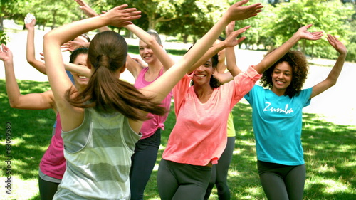 Zumba class dancing in the park