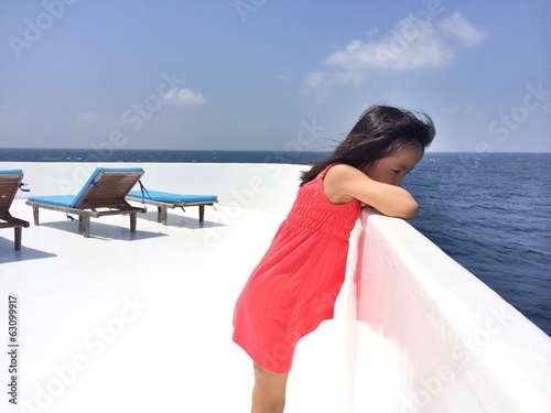 An chinese girl on boat