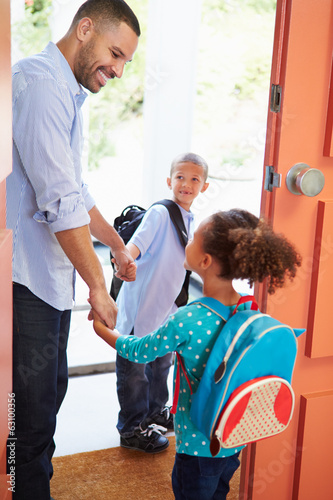 Father Saying Goodbye To Children As They Leave For School