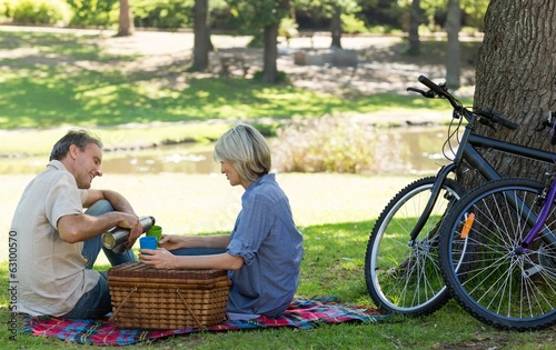 Couple enjoying coffee in park