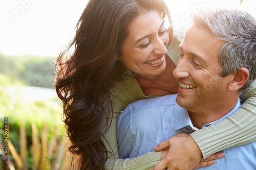 Leinwanddruck Bild Loving Hispanic Couple In Countryside