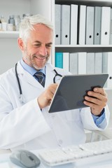 Doctor using digital tablet at medical office