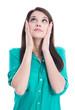 Junge Frau blickt fassungslos nach oben - isolier auf Weiß