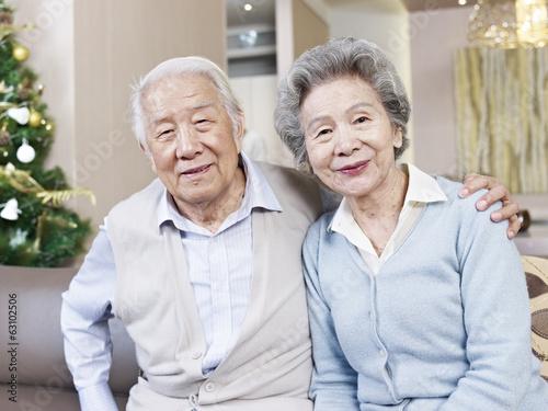 Poster home portrait of senior asian couple