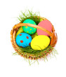 Easter eggs in wicker on white background
