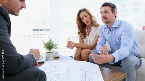 Couple talking to their architect