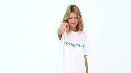 Pretty volunteer pointing to camera