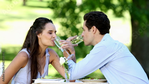 Couple having a romantic meal together outside