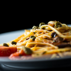 Plate of cooked savory Italian spaghetti