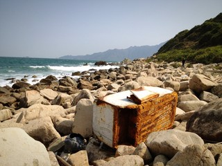 Rusty fridge on the beach