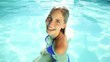 Pretty blonde swimming in a pool