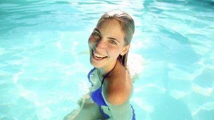 Pretty blonde swimming in a pool