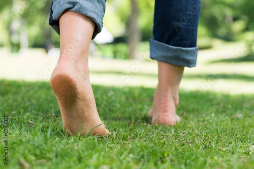 Woman walking on grass