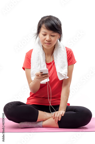 Woman listening to music in exercise outfit