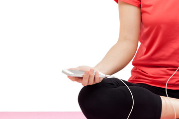 Woman holding smart phone in sport outfit